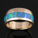Australian opal wedding band in 14k gold by Hileman