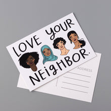 """Love Your Neighbor"" postcards feature an image of four diverse women on a white background. Illustrated by Kim Bonner."