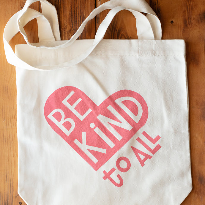 Be Kind to All cream canvas tote bag with pink ink