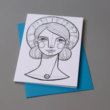 Greeting card featuring a black and white line drawing of a girl with a halo. It is on top of a blue envelope.