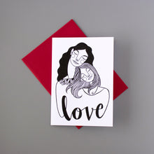 "Coloring card by Kim Bonner. Image of a mother and daughter with the word ""Love""."