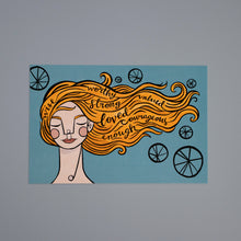 Front of the Identity postcard: A woman with orange hair on a blue background. Encouraging words are in her hair that blows in the wind.
