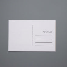 The back of the Identity postcards feature space for writing a message and space to add the address of the person you are mailing the postcard to.