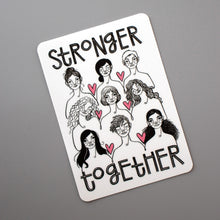 "Stronger Together vinyl sticker from Make Lovely Things. Illustration by Kim Bonner features nine women with the words, ""Stronger Together""."