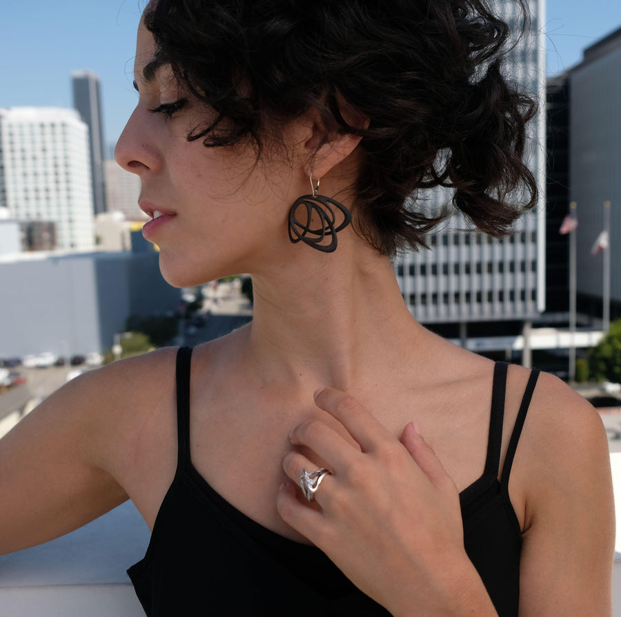 side profile of Gemino earrings in black nylon