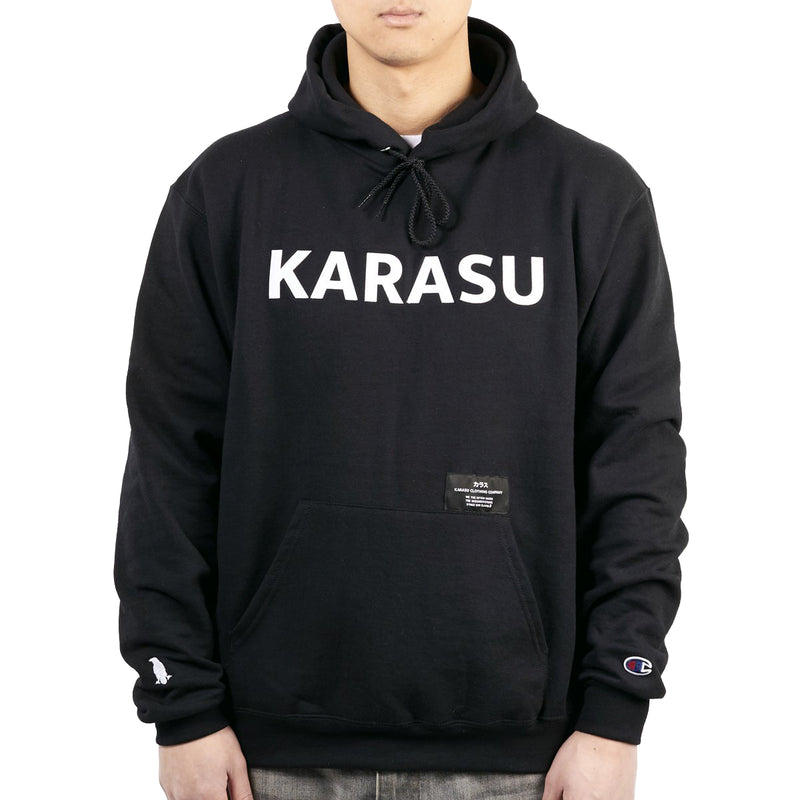 Karasu Clothing Co x Champion Collaboration - Black pullover hoodie, tackle twill embroidered, with silk label and Karasu/Champion logos, model