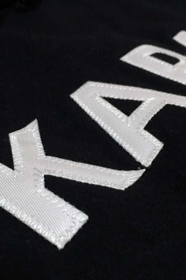 Karasu Clothing Co x Champion Collaboration - Black pullover hoodie, tackle twill embroidered, detail shot