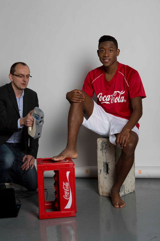Alaba getting his foot scanned by the Artec Eva