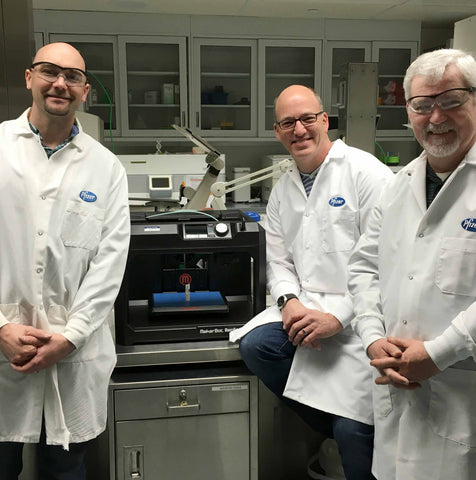 3 Pfizer scientists with MakerBot 3D Printer