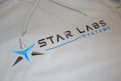 Star Labs Vintage Hooded Sweatshirt showing close-up of Star Labs Systems logo in Vintage Grey