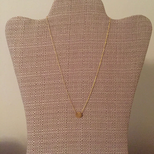 Dainty gold disc pendant necklace perfect for everyday wear and to layer with your other favorite styles. Measures 16