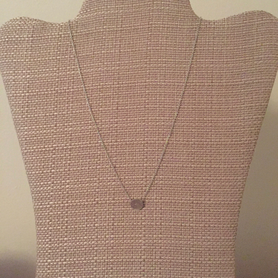 Dainty silver disc pendant necklace perfect for everyday wear and to layer with your other favorite styles. Measures 16