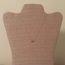 "Three dainty stars in gold, silver and rose gold strung on a gold chain. Cute and fun way to rock the mixed metal trend. Measures 16"" with a 2.5"" extension."