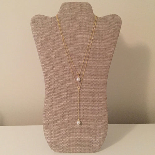 Beautiful layered pearl lariat with an adjustable longer layer. Shortest layer measures 16