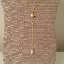 "Beautiful layered pearl lariat with an adjustable longer layer. Shortest layer measures 16"" with a 2"" extension. Longer adjustable layer measures 18"" in total."