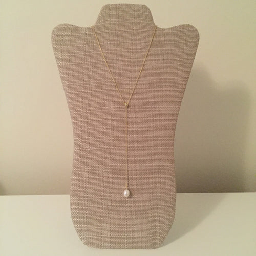 Beautiful pearl lariat with an adjustable drop length. Measures 20