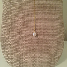 "Beautiful pearl lariat with an adjustable drop length. Measures 20"" with a 2"" extension."
