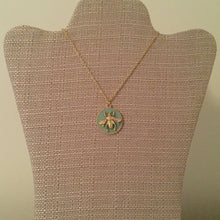 "Signature royal bee pendant necklace perfect to wear with any look. Measures 19.5"" with a 2"" extension."