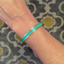 This green enamel cuff is perfect for stacking with your other favorite bracelets, and just as stylish when worn alone. Adjustable in size.