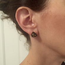 Chic black stone studs accented with gold flecks, great for everyday wear.