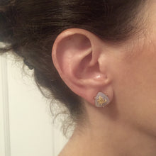 Chic gray stone studs accented with gold flecks, great for everyday wear.