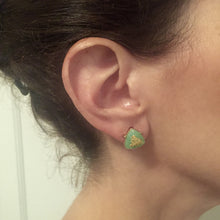 Chic green stone studs accented with gold flecks, great for everyday wear.
