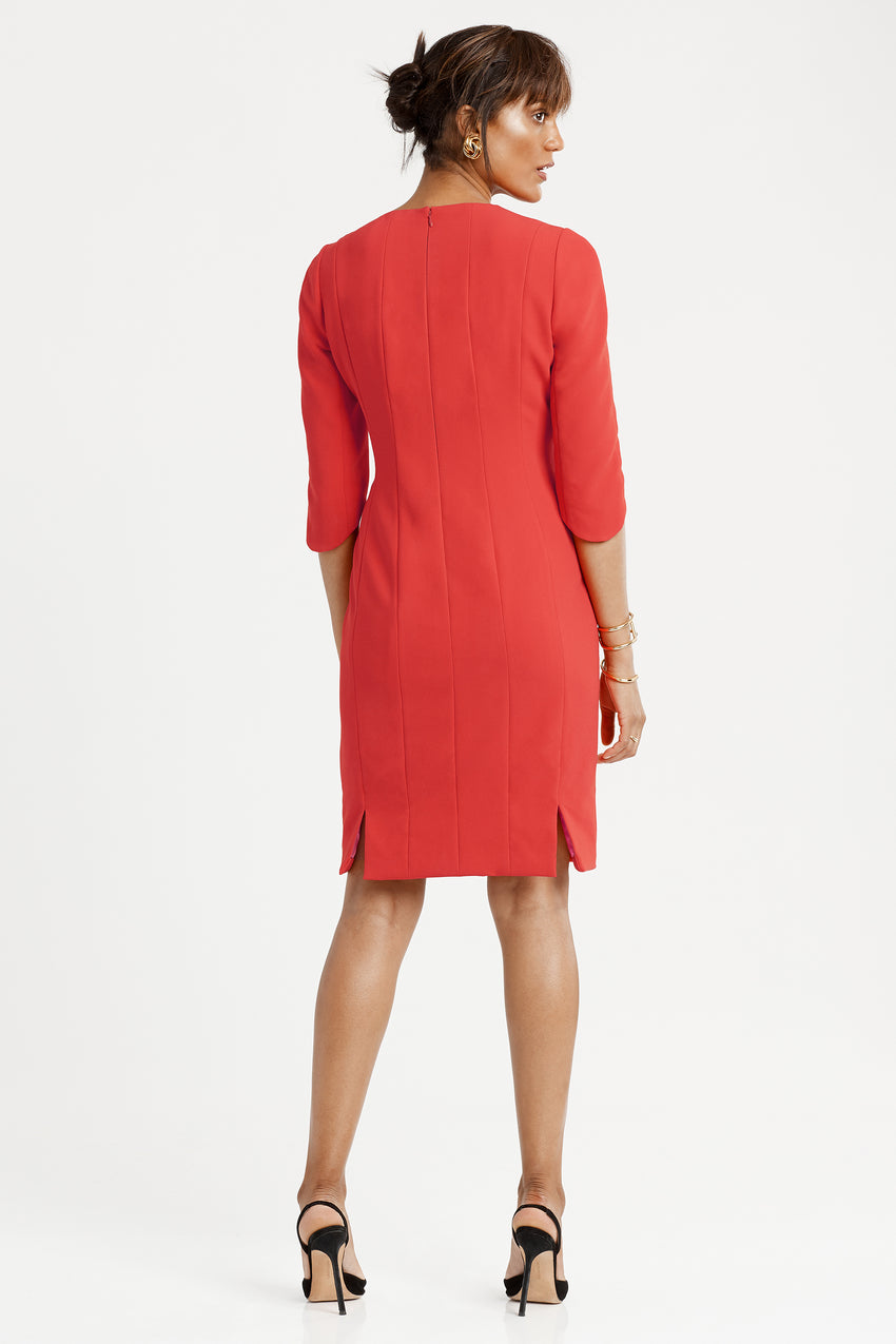 Back profile of princess seamed Crepe Sculpted Sheath Dress in red