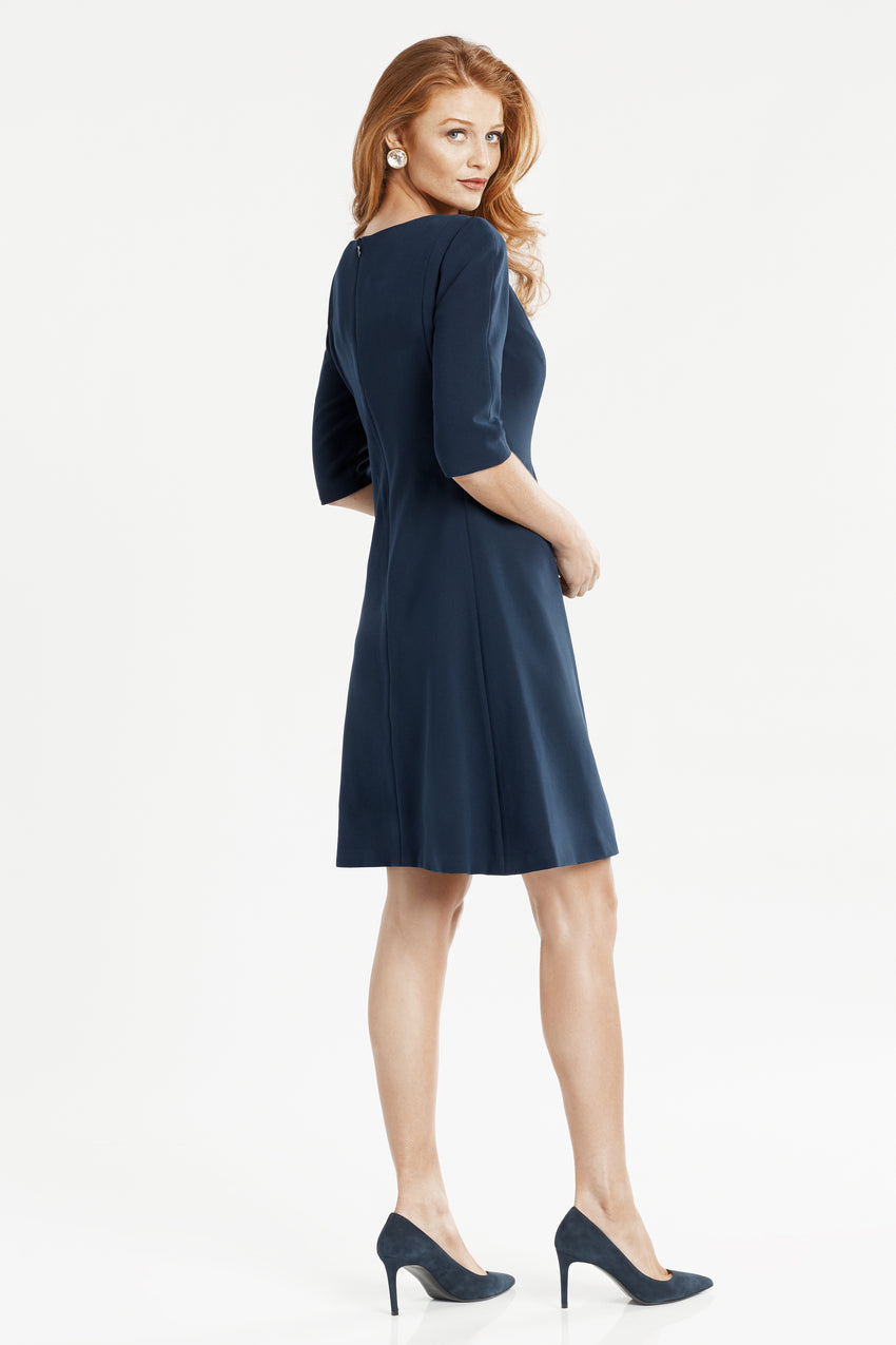 Side profile of split neck fit and flare dress in navy