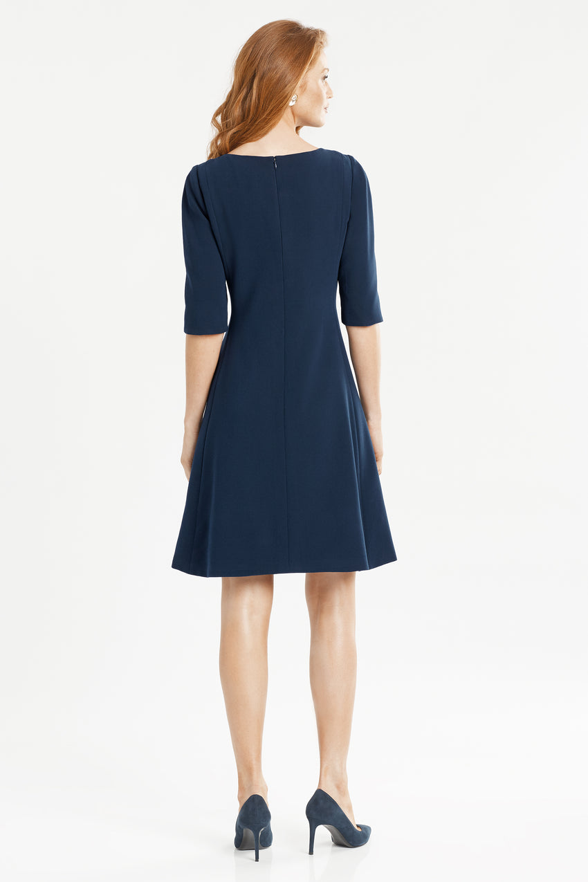 Back profile of split neck fit and flare dress in navy