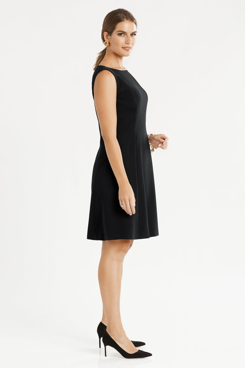 Side profile of sleeveless Front Pleat Fit & Flare Dress in black
