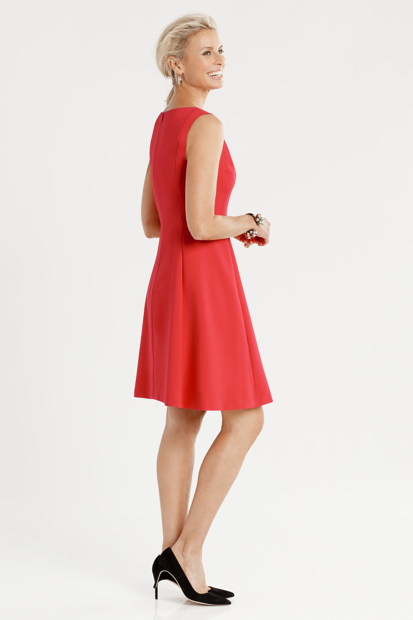 Side profile of sleeveless Front Pleat Fit & Flare Dress in red