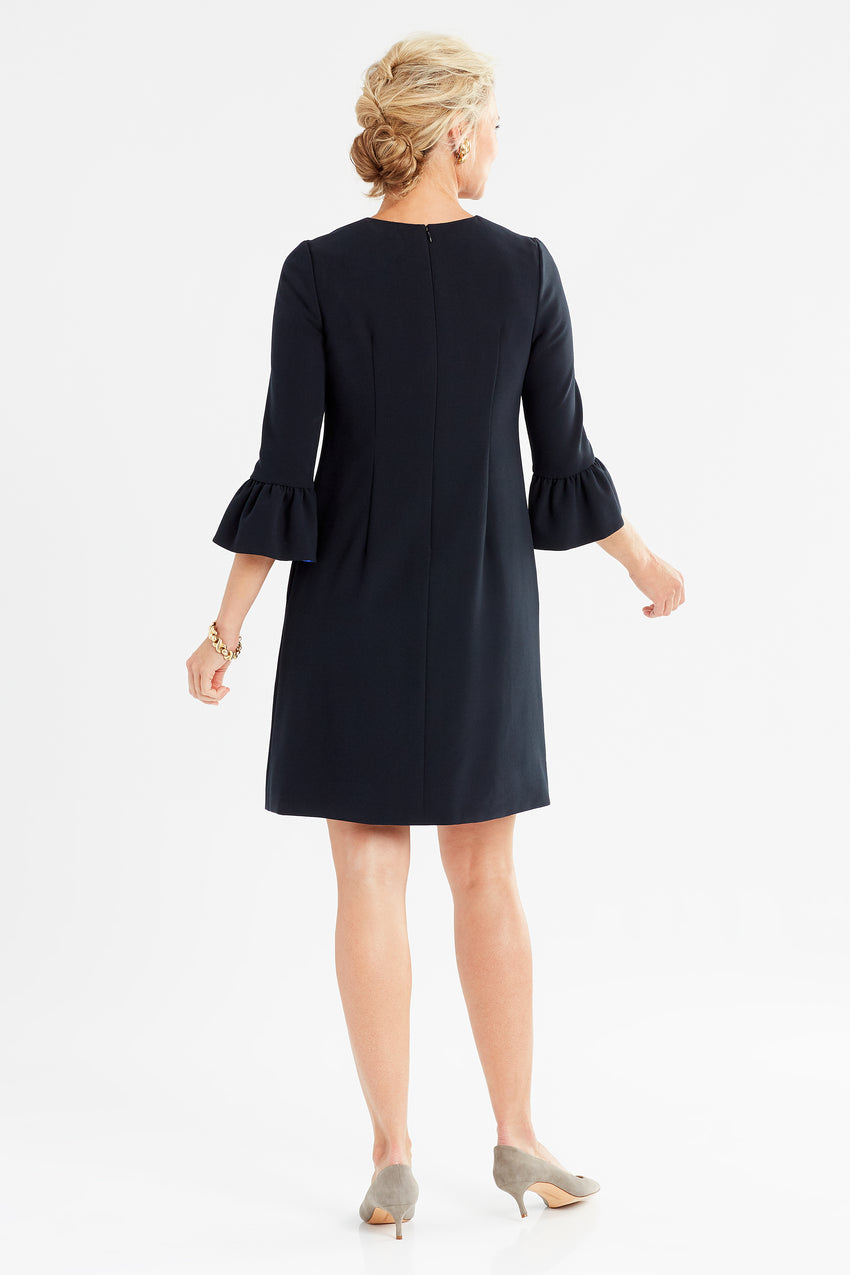 Back profile of bell sleeve a-line dress in black