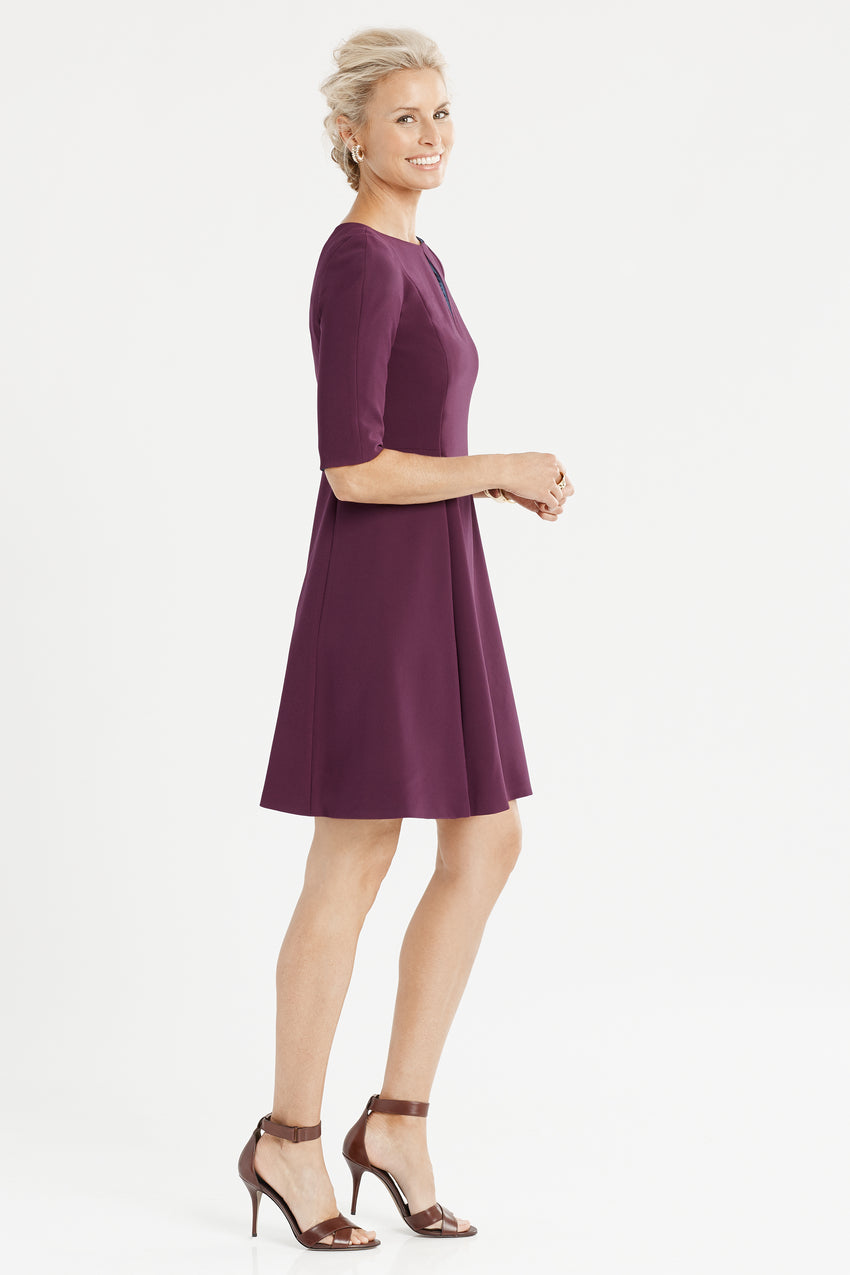 Side profile of split neck fit and flare dress in aubergine/purple/eggplant