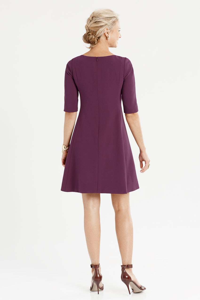 Back profile of split neck fit and flare dress in aubergine