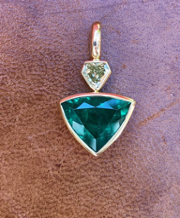 Shield Colombian emerald fancy yellow diamond pendant