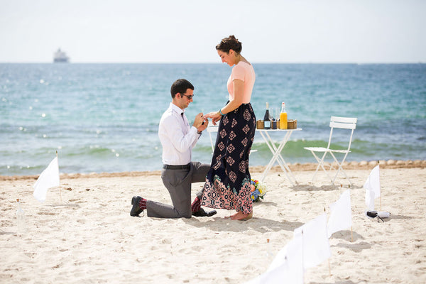 Florida beach surprise proposal with slim ring box