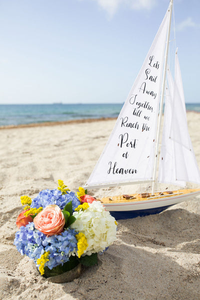 Custom wording on mini sailboat with flowers
