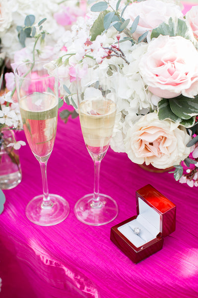 ring and champagne on table