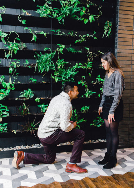 wedding proposal in front of greenery