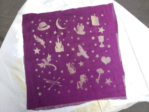 purple fabric with symbols