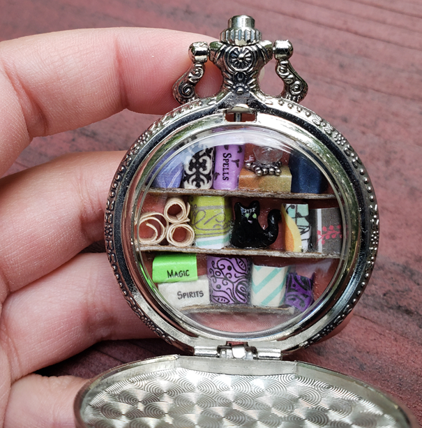 Pocket Watch Library with Green-Eyed Black Cat, Silver