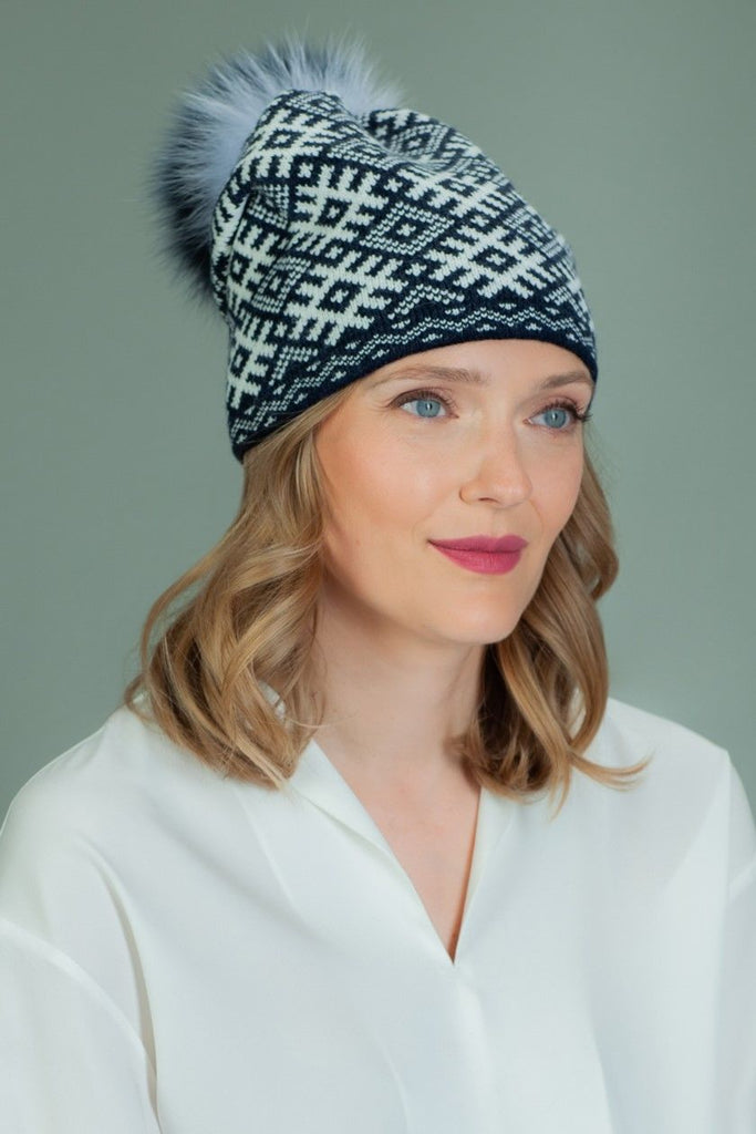 Knit Wool Beanie Hat With Fox Fur Pom-Pom in White Rhombus Pattern in Dark Blue Background