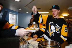 Pens Serve Thanksgiving Meal at Rainbow Kitchen
