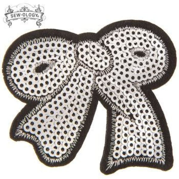 Silver Bow Sequin Iron-On Applique 1613900 1 pc. - Crafters Supply