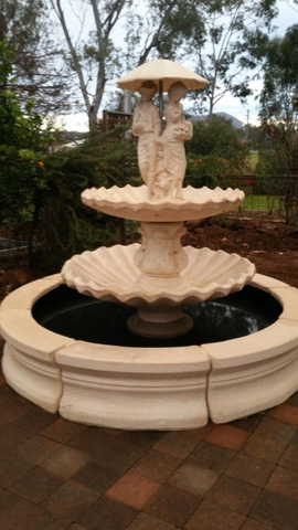 2 tier scollup fountain with spring time and traditional pond