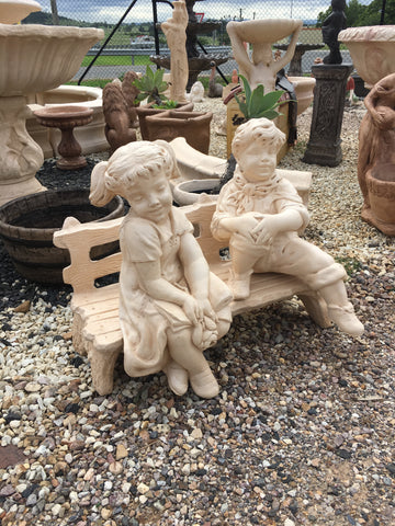 Boy and girl on the seat statue