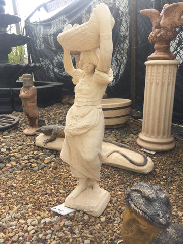 Tall basket carrying lady statue