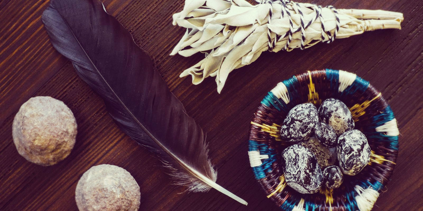 Feathers, stones, and sage.