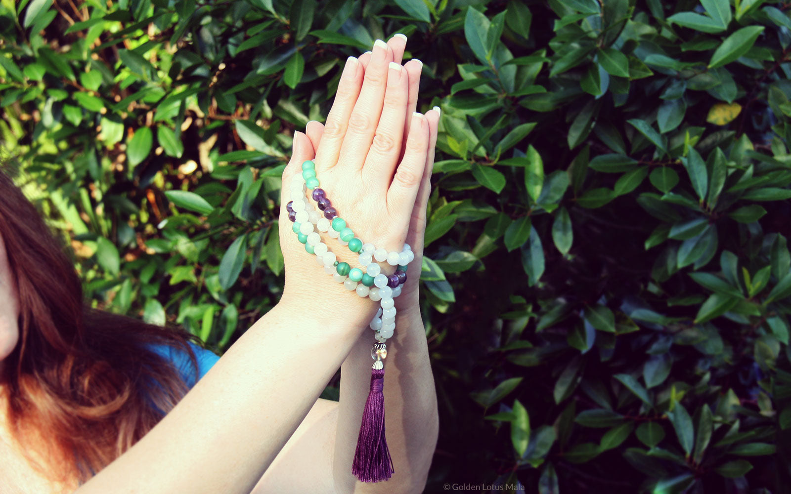 Holding Mala Beads in Prayer Pose
