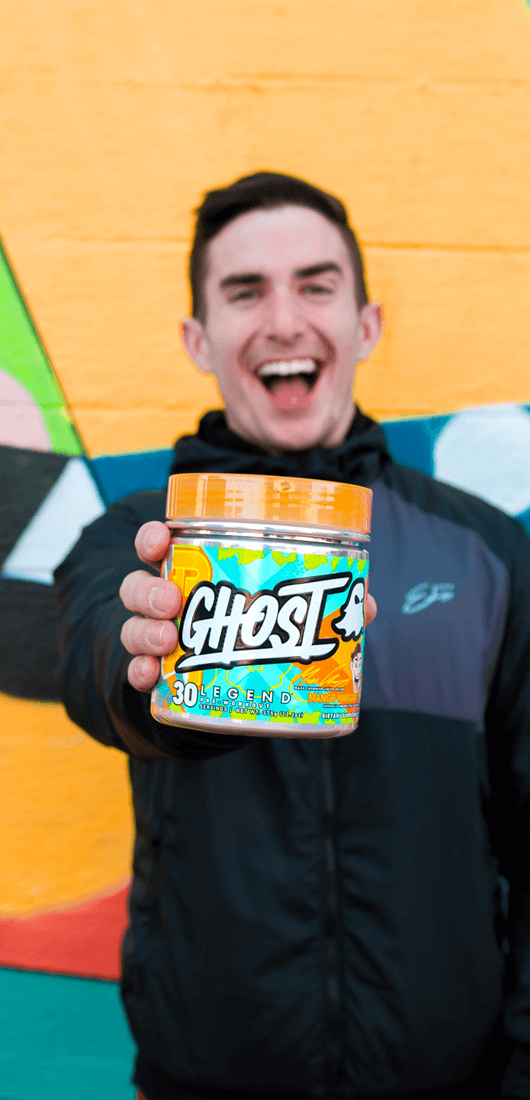 Maxx Chewning holding his limited edition pre workout